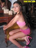True Tere in pink hot pants with ruffles